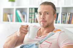 Young man drinking tea Royalty Free Stock Images