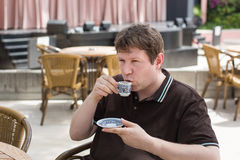 Young man drinking traditional turkish mocca coffee Royalty Free Stock Images