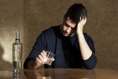 Young man drinking vodka Stock Photography