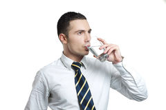 Young man drinking water royalty free stock photo