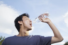 Young Man Drinking Water Stock Image