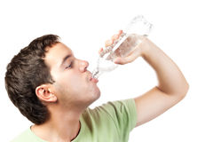 Young man drinking water from bottle isolated Royalty Free Stock Image