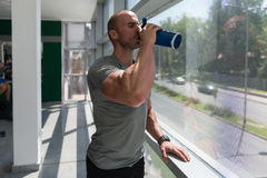 Young Man Drinking Water From Bottle Stock Photo