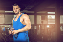Young man drinking water in gym Royalty Free Stock Image