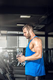 Young man drinking water in gym Royalty Free Stock Photos