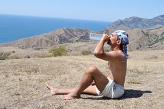 A young man drinking water Stock Photography