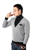 Young man drinking whiskey Royalty Free Stock Photos