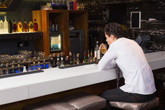Young man drinking whiskey neat Stock Photo