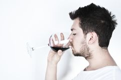 Young man drinking wine Royalty Free Stock Image