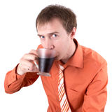 The young man drinks coffee. Isolated Stock Photos