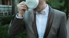 Young Man Drinks Coffee Outdoor stock video
