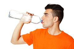Young man drinks water Stock Image