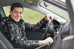 Young man driver in a car Stock Photography