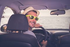 Portrait of young tourist car driver. Travel and summer vacation stock image