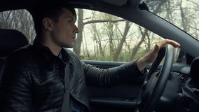 Young man drives car stock footage