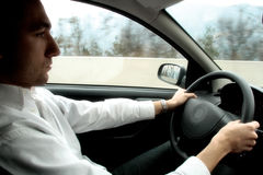 Young man drives  Stock Photography