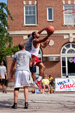 Young Man Drives To Basket In Outdoor Street Basketball Tournament Royalty Free Stock Photography