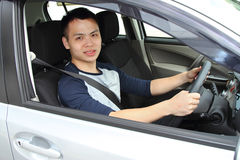 Young man driving Stock Photos
