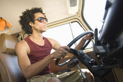 Young Man Driving Campervan. Low angle view of a young men driving campervan Royalty Free Stock Photos