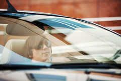 Young man driving a car Stock Image