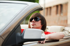 Young man driving a car Royalty Free Stock Photos