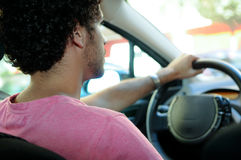 Young man driving a car Royalty Free Stock Image