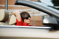 Young man driving a car Stock Photography