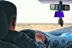 Young man driving a car. royalty free stock photography