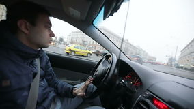 A young man driving car. stock footage