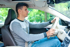 Young man driving car Royalty Free Stock Photography