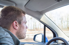 Young man driving a car Stock Images