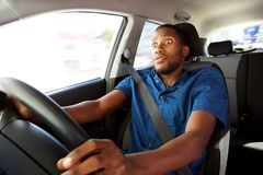 Young man driving a car with surprised expression Royalty Free Stock Photos
