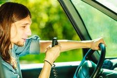 Young man driving car using cb radio Stock Photos