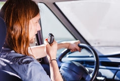 Young man driving car using cb radio Royalty Free Stock Images