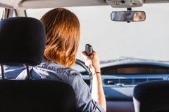 Young man driving car using cb radio Stock Photography