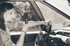 Young man driving car using cb radio Royalty Free Stock Photo