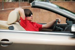 Young man driving a convertible Stock Photography