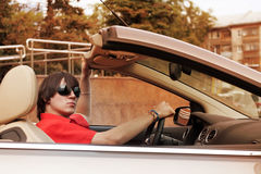 Young man driving a convertible car Royalty Free Stock Photography