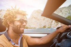 Young man driving a convertible car. Royalty Free Stock Photo