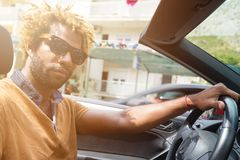 Young man driving a convertible car. Stock Photography