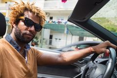 Young man driving a convertible car. Stock Image