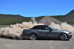 Young Man Driving and Drifting a Mustang Royalty Free Stock Photo
