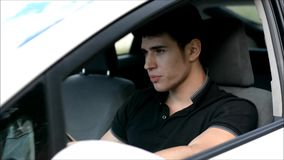 Young man driving while drinking alcohol stock footage