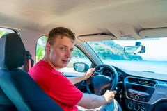 Young man driving his car Stock Images