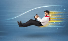 Young man driving in imaginary fast car with blurred lines. Concept Royalty Free Stock Image