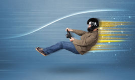 Young man driving in imaginary fast car with blurred lines Stock Photo