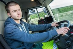 Young man driving lorry. Man stock image