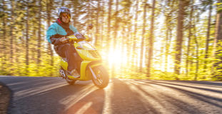 Young man driving scooter, blur motion Stock Images