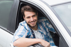 Young man driving and smiling Stock Photography
