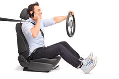 Young man driving and talking on phone Royalty Free Stock Images
